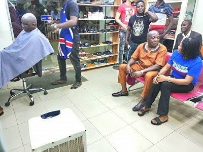 Governor Fayose Spotted Having  Haircut in Public Salon (Photos)