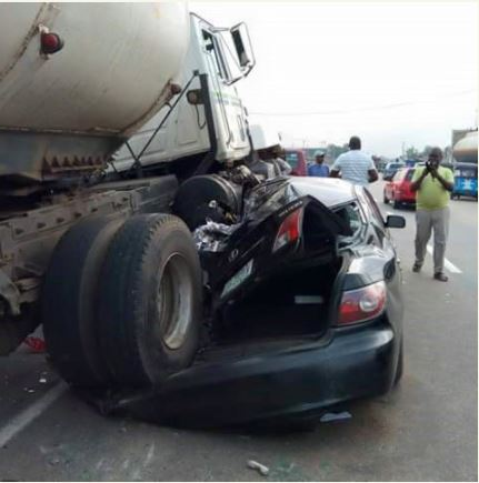 Tanker Climbs Over Man's Car In Warri Then This Shocking Thing Happened (Photos)