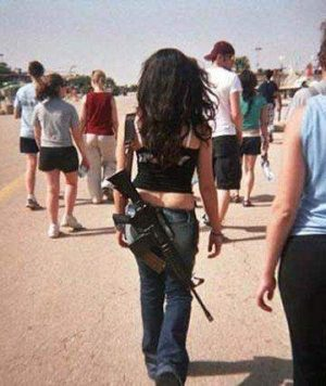 How common is it for Jewish women in Israel to carry military grade rifles as fashion accessories?