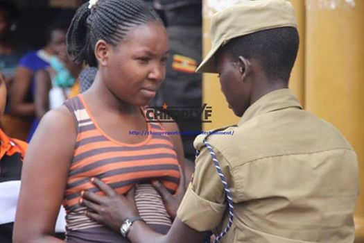 Ugandan Police Pictured Squeezing Women BrEast During Search Operation