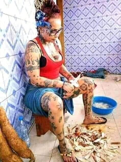 Heavy Tattooed Igbo Slay Queen Captured Peeling Yam in the Kitchen