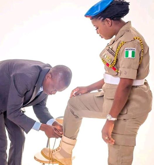 Viral Photo of Husband Bending Down to Tie Shoelace of his Wife who is an Officer