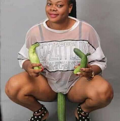 Yoruba Slay Queen Sits on Her Favourite Cucumber for a Photo shot