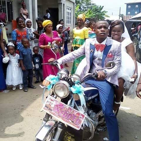 Nigerians React as Man Carries His Newly Wedded Bride on Bike