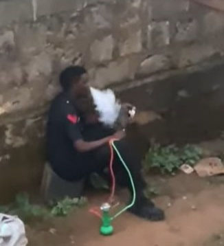 Watch the Viral Video of Nigerian Police Officer Smoking Shisha on Duty