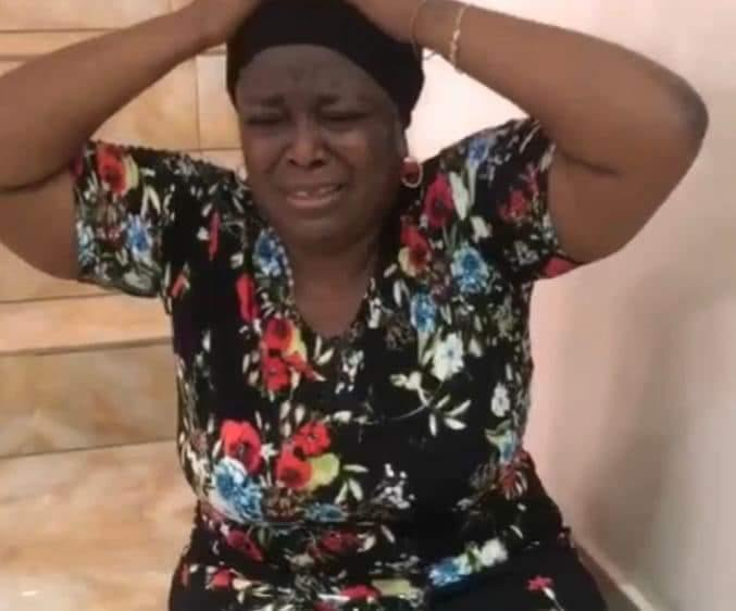 VIDEO: Mike Adenugu's Mistress Cries In Pain As EFCC Tries to Evict Her